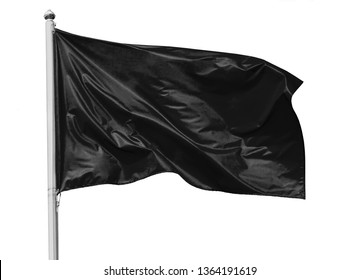 Black flag waving in the wind on flagpole, isolated on white background, closeup