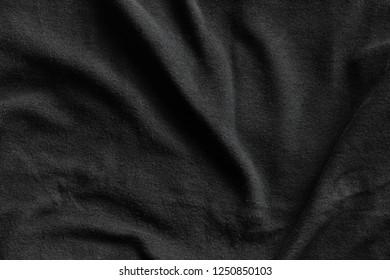 Black fleece, texture of soft napped insulating fabric made from polyester, wavy pattern