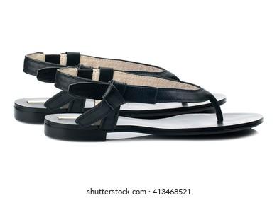 Black flip flops isolated on white background.