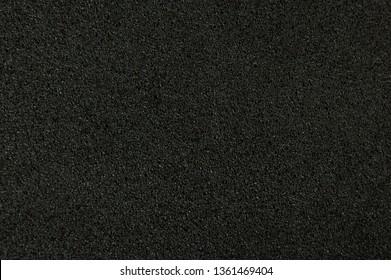 Black foam paper background macro close up view