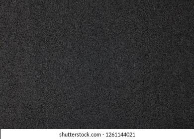Black foam surface.