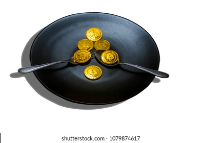 Black food plate, with spoon and golden bitcoin on white background, abstract business concept of modern business, comparable bitcoin, like food to eat.