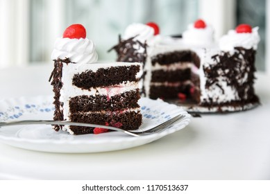 Black forest cake decorated with whipped cream and cherries. Isolated on white background. piece of cake. Christmas cake
