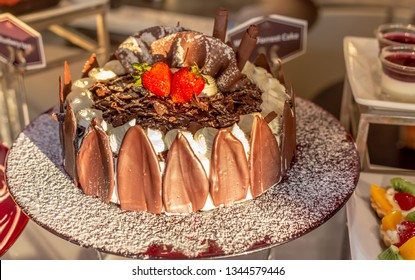 Black forest cake decorated with whipped cream and cherries, dark chocolate and cherry dessert