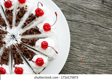 Black forest cake and on wooden background