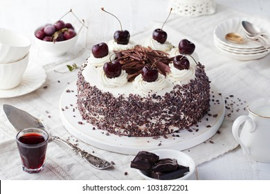 Black forest cake, Schwarzwald pie, dark chocolate and cherry dessert on a white wooden background.