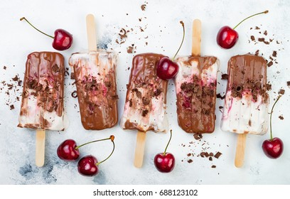 Black Forest chocolate fudge popsicles with roasted cherries and coconut cream. Vegan creamy ice pops, nicecream, fudgesicles
