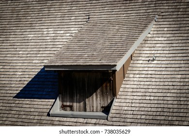 A black forest farm roof of wooden shingles with a dormer