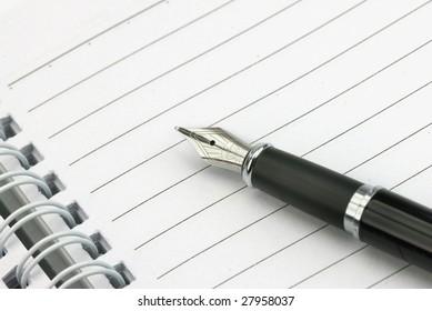 Black Fountain Pen on Notebook