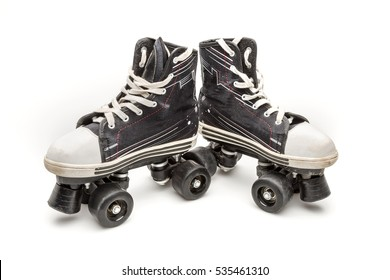 Black four-wheel skates used, isolated on a white background