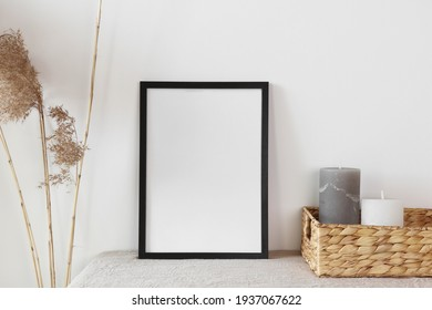Black frame with candle and cane