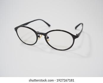 Black frame eyeglasses on a white background.