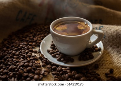 black fresh coffee cup with roasted cofe beans