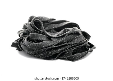 Black fresh tagliatelle pasta with squid ink on a white isolated background - Shutterstock ID 1746288305