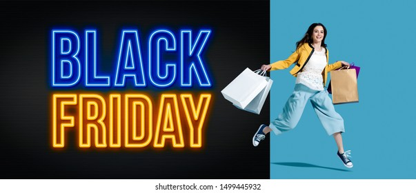 Black friday advertisement with cheerful shopping girl holding lots of bags, sale and offers concept