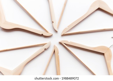 Black Friday or clothing industry concept on white background flat lay with randomly scattered wooden clothes hangers pattern