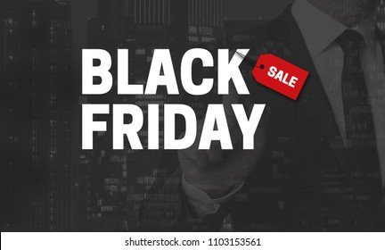 Black Friday concept is shown by businessman.