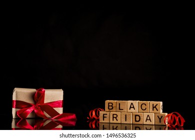 Black friday cubes with present on black background