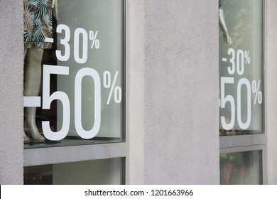 black friday discounts.discount day.a showcase of a clothing store, on which 30 percent is written and 50 percent discount on products.sell-out.Christmas sale, holiday markdown, marketing ploy