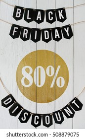Black Friday eighty percent Discount paper banner garland lettering hanging on white barn wood planks background. Luxurious vertical holiday flyer.