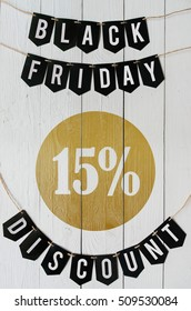 Black Friday fifteen percent Discount paper banner garland lettering hanging on white barn wood planks background. Luxurious vertical holiday flyer.