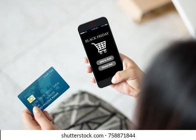 Black friday online shopping concept.hands using mobile phone and holding credit card