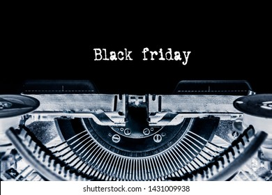 Black friday printed on a sheet of paper on a vintage typewriter.  Discounts, sale.