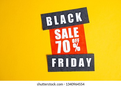 Black Friday sale concept. Discount seventy percent. Sale sticker on yellow background.