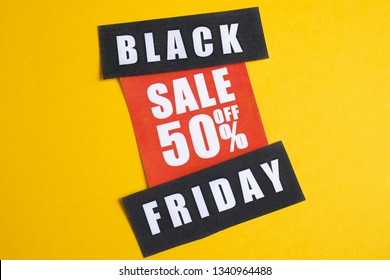 Black Friday sale concept. Fifty percent discount. Sale sticker on yellow background.