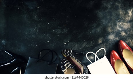 Black friday sale concept on black surface, top view to women shoes