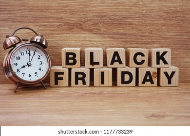 black friday sale shopping concept alphabet on wooden background