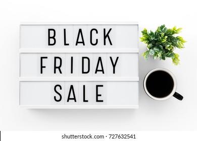 Black friday sale word on lightbox on white table