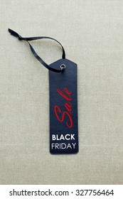 Black Friday sales tag. Black Friday shopping sale concept with black ticket Sale tag close up.