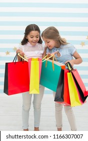 black friday at school market. happy small kids girls with shopping bags after black friday sale. small kids with purchase from school market.go shopping. Best discounts and promo codes