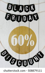 Black Friday sixty percent Discount paper banner garland lettering hanging on white barn wood planks background. Luxurious vertical holiday flyer.