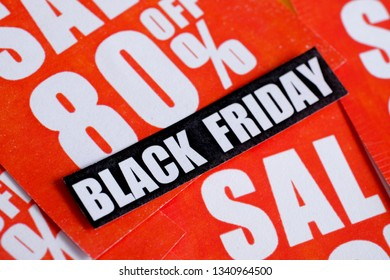 Black friday sticker on red stickers with various discounts.