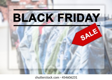 Black Friday text on blurred shopping mall background.
