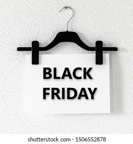 Black Friday text on white paper hanging on clothespins on black clothes hanger on screw on grey textured  wallpaper background. Hanger for trouser and skirt and paper, Black Friday sale concept