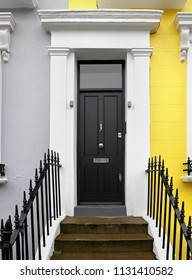 Black front door of residential house with doorstep