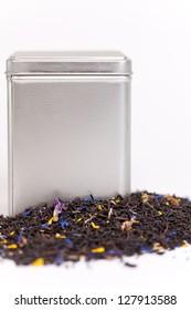 Black fruit tea spilling out of a tea box