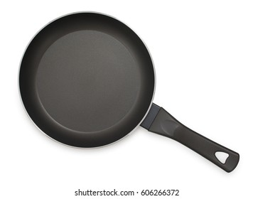 Black frying pan with nonstick surface isolated on white background, close-up, top view.