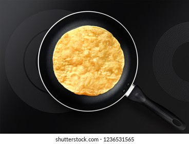 black frying pan with pancake on induction plate
