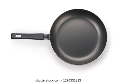 Black frying pan top view. Isolated on white, clipping path included