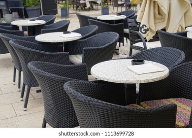 Black furniture in a coffee shop cafE on the waterfront of Trogir, Croatia