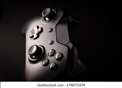 Black game controller in close view
