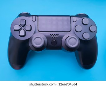 black game controller on colored paper