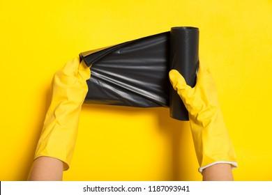 Black garbage container roll, disposal bin. Waste bag.