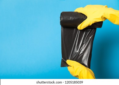Black garbage container roll, disposal bin. Waste bag.