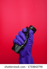 Black garbage container roll, disposal bin. Waste bag. colorful gloves on yellow background. colorful gloves