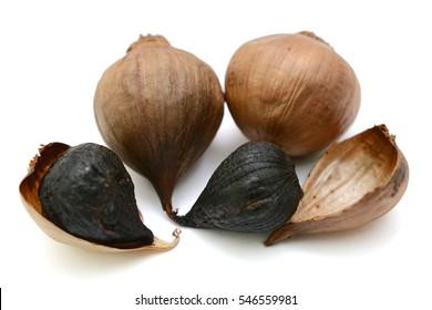 Black Garlic (Allium sativum) isolated on white background